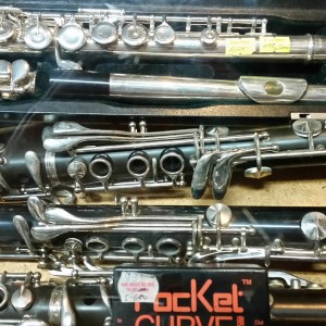 Assorted clarinets and flutes at various prices